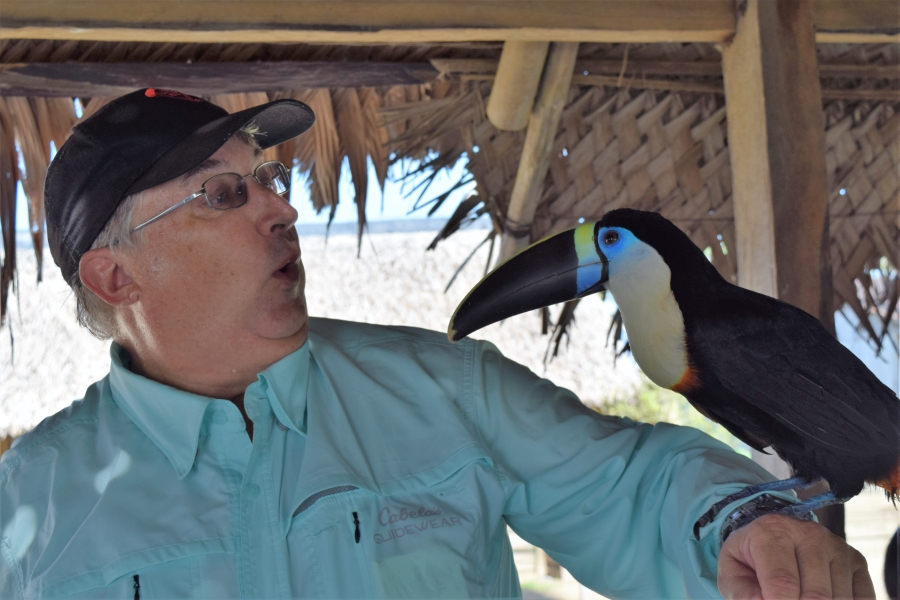 Dr. Dennis and toucan in the Amazon!