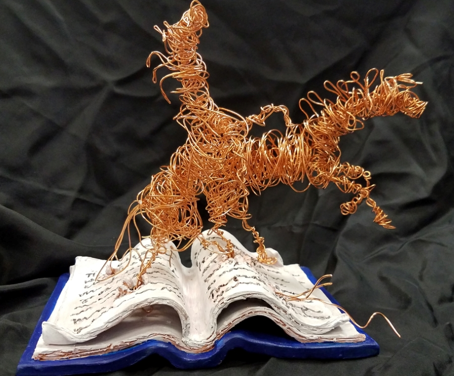 image: two wire horses running off of page in clay book